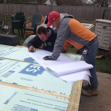 Our awesome contractors looking at the blueprints!