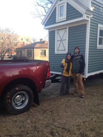 Us with our Tiny House hitched up to our drivers truck! Goodbye Chicago!