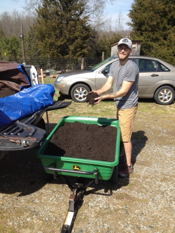 3.3.16 Richard showing off some of the topsoil we used for the beds.